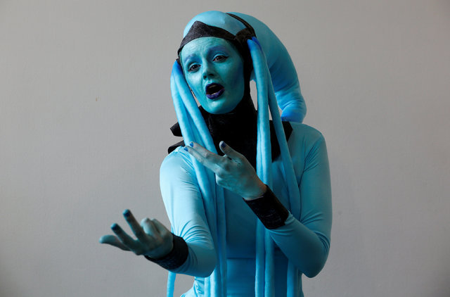 Leah Thomas, dressed as the character Diva Plavalaguna from The Fifth Element movie, poses for a picture as she attends opening day Comic-Con International in San Diego, California, U.S. July 21,  ...
