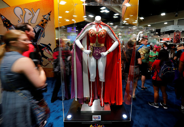 An original Wonder Woman costume is viewed by attendees during opening day of Comic-Con International in San Diego, California, United States July 21, 2016. (Mike Blake/Reuters)