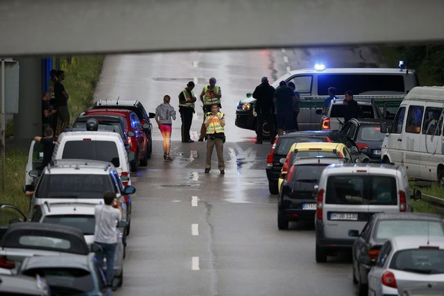 Police halt traffic on a road near to the scene of a shooting rampage at the Olympia shopping mall in Munich, July 22, 2016. (Michael Dalder/Reuters)