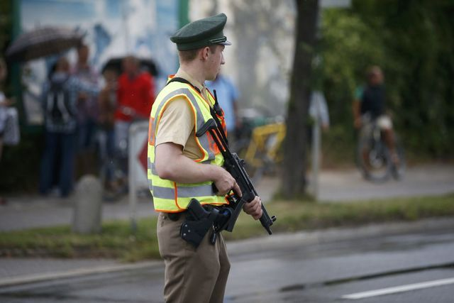 A police officer secures a road near to the scene of a shooting rampage at the Olympia shopping mall in Munich,  July 22, 2016. (Michael Dalder/Reuters)