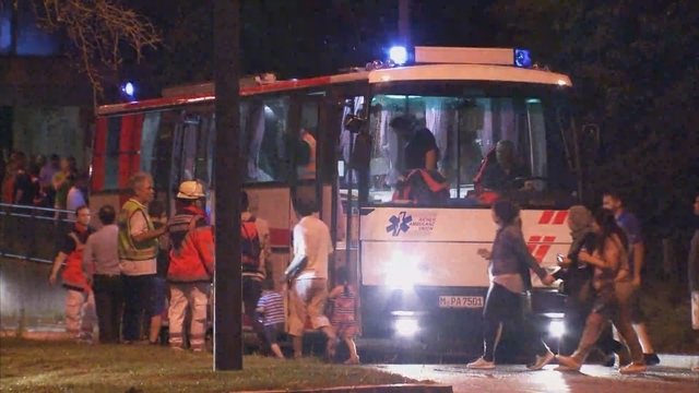 A screen grab taken from video footage shows people being evacuated onto a bus following a shooting rampage at the Olympia shopping mall in Munich, Germany. July 22, 2016. (Reuters TV)