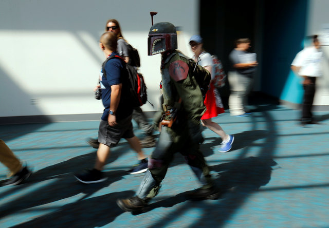 An attendee dressed as Boba Fett from Star Wars rushes his way at the pop culture event Comic-Con International in San Diego, California, United States July 22, 2016.    (Mike Blake/Reuters)
