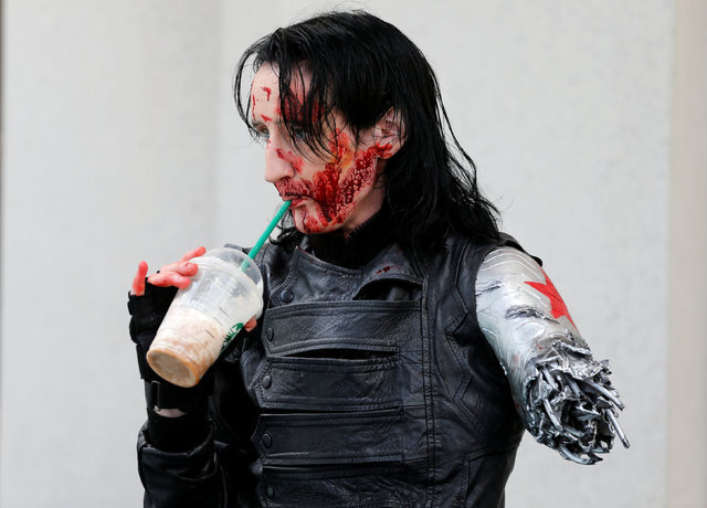 Dawn Richardson grabs a Starbucks drink in the costume of the Winter Soldier at the pop culture event Comic-Con International in San Diego, California, United States July 22, 2016.    (Mike Blake/ ...