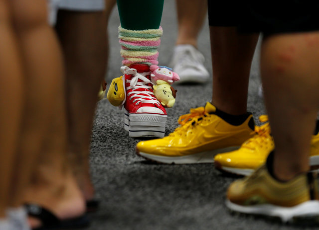 Some of the footwear worn by attendees is shown at the pop culture event Comic-Con International in San Diego, California, United States July 22, 2016. (Mike Blake/Reuters)