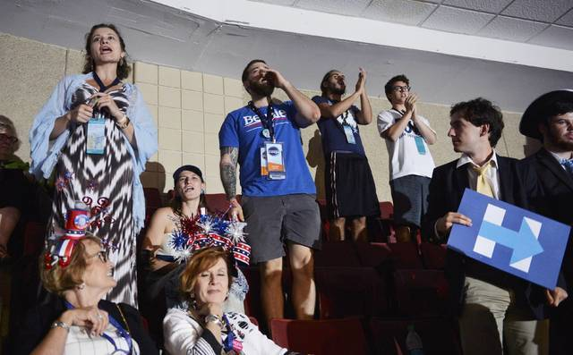 Supporters of former Democratic Presidential candidate Senator Bernie Sanders react after he moved to suspend the rules and nominate Hillary Clinton during the Democratic National Convention in Ph ...