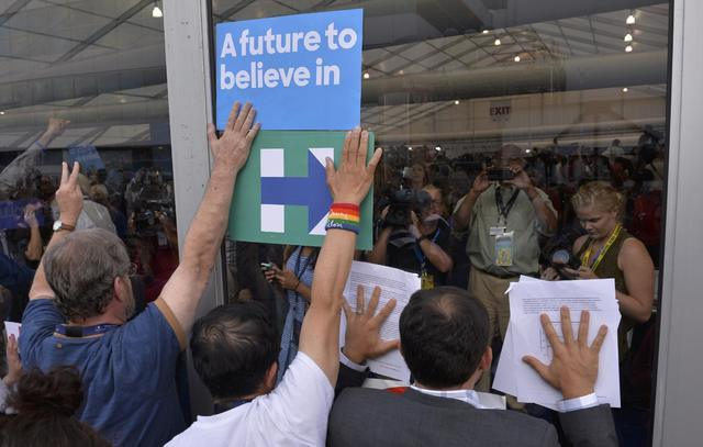 Supporters of former Democratic Presidential candidate Senator Bernie Sanders protest at the media center after walking out when Hillary Clinton was nominated at the Democratic National Convention ...