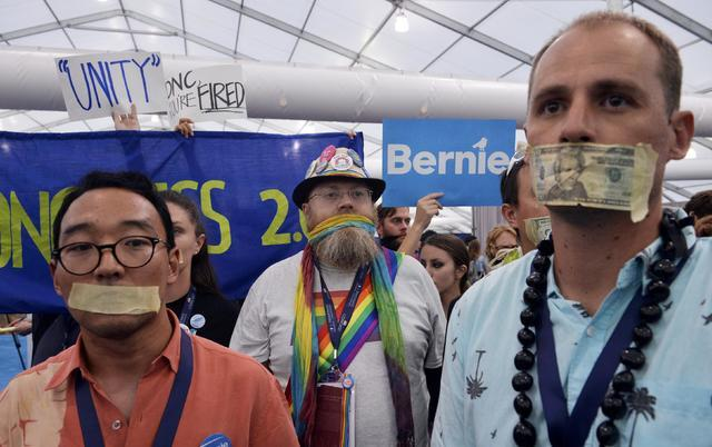 Supporters of former Democratic presidential candidate Bernie Sanders protest in the media center after they walked out of the convention once Hillary Clinton was nominated during the Democratic N ...