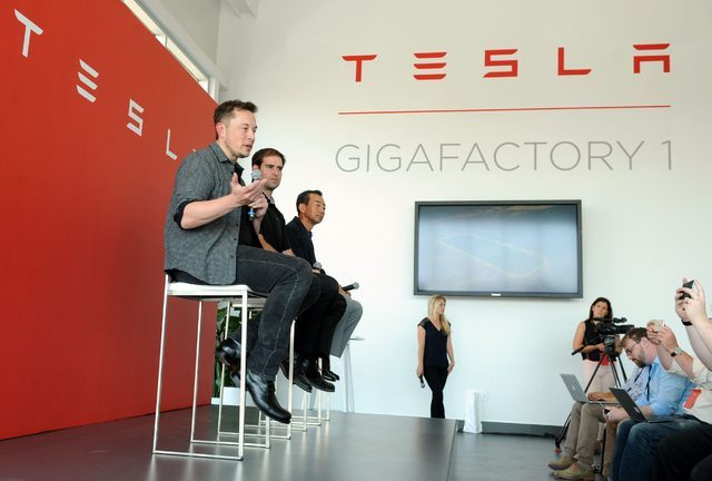 L-R: Tesla Chief Executive Elon Musk, Tesla Chief Technical Officer JB Straubel and Yoshi Yamada senior advisor from Panasonic participate in a news conference at the Tesla Gigafactory near Sparks ...