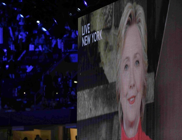Democratic U.S. presidential nominee Hillary Clinton appears on a video monitor streamed live from New York at the Democratic National Convention in Philadelphia, Pennsylvania, U.S. July 26, 2016. ...