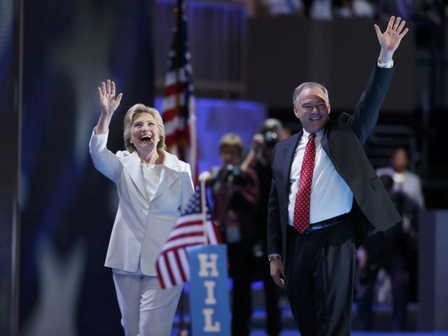 Hillary Clinton waves with her vice-presidential running mate, U.S. Sen. Tim Kaine, after accepting the nomination on the fourth and final night at the Democratic National Convention in Philadelph ...
