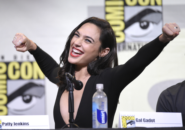 "Gal Gadot makes a Wonder Woman pose at the ""Wonder Woman"" panel on day 3 of Comic-Con International on Saturday, July 23, 2016, in San Diego. (Chris Pizzello/Invision/AP)"