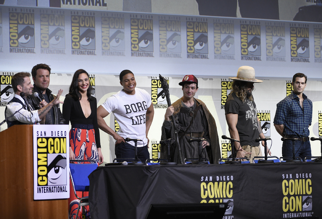 "Director Zack Snyder, from left, and actors Ben Affleck, Gal Gadot, Ray Fisher, Ezra Miller, Jason Momoa, and Henry Cavill attend the ""Justice League"" panel on day 3 of Comic-Con International on  ..."