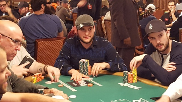 Professional poker player Bryan Piccioli of Allegany, New York, center, will have the lead when play resumes Saturday afternoon on Day 5 of the World Series of Poker's $10,000 buy-in No-limit Te ...