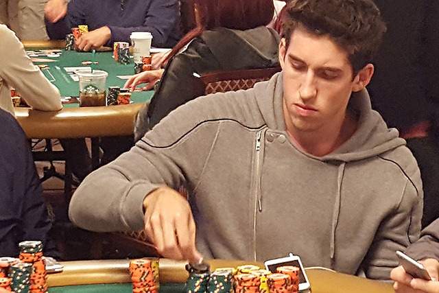 Professional poker player Daniel Colman, center, leads the World Series of Poker's $10,000 buy-in No-limit Texas Hold 'em World Championship at the dinner break on Day 5 Saturday at the Rio Conv ...