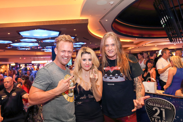 DJ Sebastian Bach, right, assists with a marriage proposal by Ryan Berwick to Jamie Ross at Center Bar on July 23, 2016, in the Hard Rock Hotel. (Jeff Ragazzo/Kabik Photo Group)