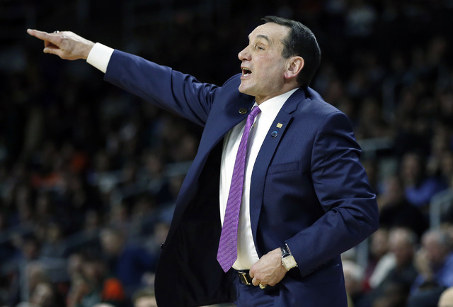 Duke head coach Mike Krzyzewski gestures during the first half of a second-round game against Yale in the NCAA men's college basketball tournament in Providence, R.I., Saturday, March 19, 2016. Kr ...