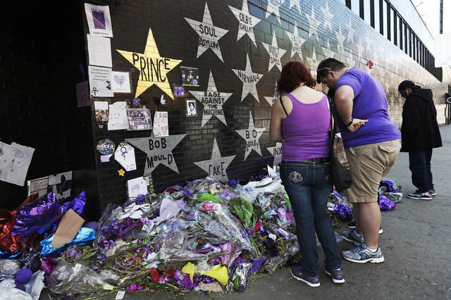 A star honoring Prince, now painted gold, stands out on the wall Thursday, May 5, 2016, as fans gathered at the memorial for the singer at First Avenue in Minneapolis where he often performed. The ...