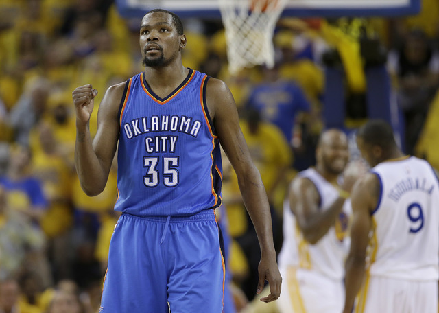 Oklahoma City Thunder forward Kevin Durant (35) reacts in this file photo (Marcio Jose Sanchez/AP)