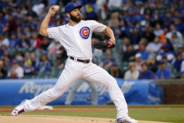 In this May file photo, Chicago Cubs starting pitcher Jake Arrieta delivers during a baseball game against the Los Angeles Dodgers in Chicago. (Charles Rex Arbogast/Associated Press)