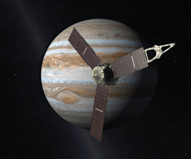 This artist's rendering provided by NASA and JPL-Caltech shows the Juno spacecraft above the planet Jupiter. Five years after its launch from Earth, Juno is scheduled to go into orbit around the g ...