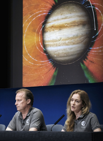 Heidi Becker, right, Juno radiation monitoring investigation lead, discusses the challenges of radiation the Juno spacecraft will encounter as Rick Nybakken, Juno project manager, left, looks on d ...