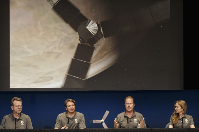 Jim Green, director, Planetary Science Division, NASA, left, talks during a media briefing joined by Scott Bolton, Juno principal investigator, second from left, Rick Nybakken, Juno project manage ...