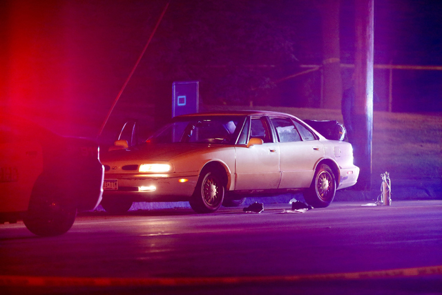 A car at the scene of a shooting of a man involving a St. Anthony Park Police officer Wednesday, July 6, 2016, in Falcon Heights, Minn. Police in Minnesota say a man has died after being shot by a ...