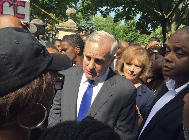 Minnesota Gov. Mark Dayton expresses his condolences to Diamond Reynolds for the death of her boyfriend, Philando Castile, outside the governor's residence Thursday, July 7, 2016, in St. Paul, Min ...