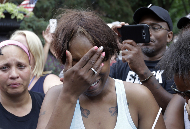 Diamond Reynolds, the girlfriend of Philando Castile of St. Paul, cries outside the governor's residence in St. Paul, Minn., on Thursday, July 7, 2016.   (Jim Mone/AP)