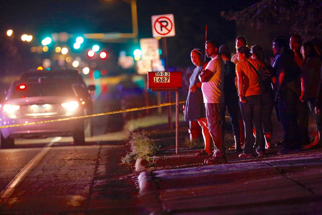 A crowd gathers at the scene of a shooting of a man involving a St. Anthony Police officer on Wednesday, July 6, 2016, in Falcon Heights, Minn. (Leila Navidi/Star Tribune via AP)