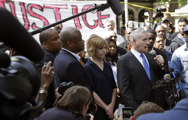 Minnesota Gov. Mark Dayton, right, speak to protesters and media outside the governor's residence Thursday, July 7, 2016, in St. Paul, Minn., after a police officer fatally shot Philando Castile.  ...