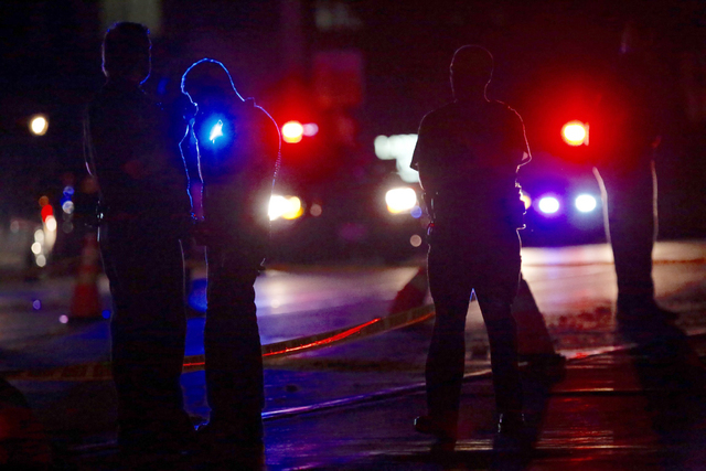 Investigators work at the scene of a police involved shooting with St. Anthony Police officers on Wednesday, July 6, 2016, in Falcon Heights, Minn. Police in Minnesota say a man has died after bei ...