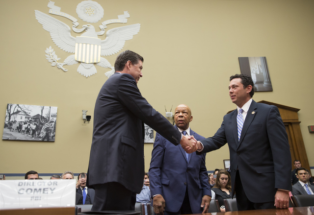 House Oversight and Government Reform Committee Chairman Rep. Jason Chaffetz, R-Utah, right, accompanied by the committee's ranking member Rep. Elijah Cummings, D-Md., center, welcome FBI Director ...