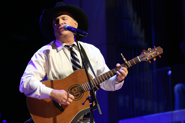 In this Oct. 25, 2015 file photo, Garth Brooks performs at The Country Music Hall of Fame 2015 Medallion Ceremony at Country Music Hall of Fame and Museum in Nashville, Tenn.  (Laura Roberts/Invis ...