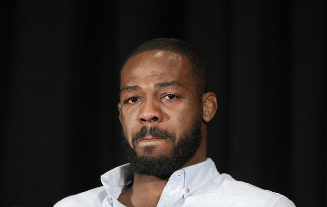 Mixed martial arts fighter Jon Jones cries as he speaks during a news conference, Thursday, July 7, 2016, in Las Vegas. Jones was scheduled to fight Daniel Cormier at UFC 200 but was pulled from t ...