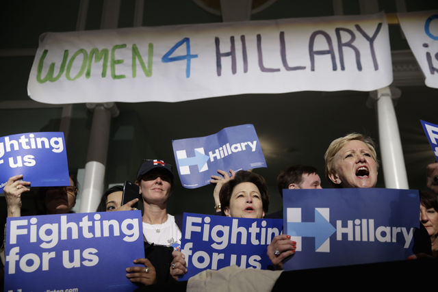 In this April 18, 2016 file photo, supporters of democratic presidential candidate Hillary Clinton cheer during a Women for Hillary event in New York.   (AP Photo/Seth Wenig, File)