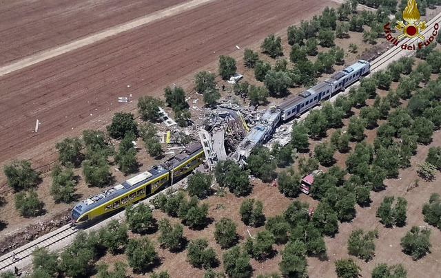 This aerial handout photo shows what is left of two commuters trains after their head-on collision in the southern region of Puglia, Tuesday, July 12, 2016. At least 20 people died and several oth ...