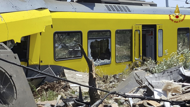 The wreckage of a crumpled wagon at the scene of a train accident after two commuter trains collided head-on in the southern region of Puglia, killing several people, Tuesday, July 12, 2016.  (Ita ...