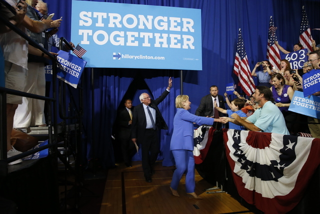 Democratic presidential candidate Hillary Clinton, followed by Sen. Bernie Sanders, I-Vt., arrives for a rally in Portsmouth, N.H., Tuesday, July 12, 2016, where Sanders endorsed Clinton for presi ...