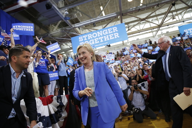 Democratic presidential candidate Hillary Clinton, followed by Sen. Bernie Sanders, I-Vt., arrives for a rally in Portsmouth, N.H., Tuesday, July 12, 2016. (Andrew Harnik/AP)
