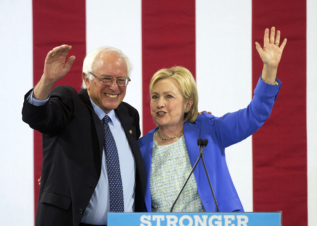 Democratic presidential candidate Hillary Clinton waves to supporters with Sen. Bernie Sanders, I-Vt., during a rally in Portsmouth, N.H., Tuesday, July 12, 2016, where Sanders endorsed her for pr ...