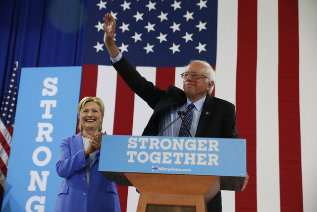 Sen. Bernie Sanders, I-Vt., waves as he and Democratic presidential candidate Hillary Clinton arrive for a rally in Portsmouth, N.H., Tuesday, July 12, 2016. (Andrew Harnik/AP)