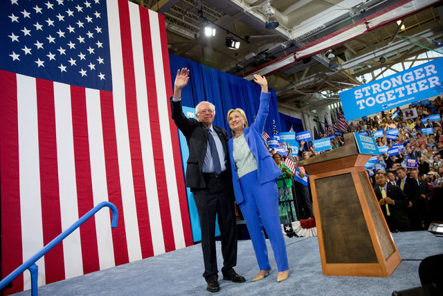 Democratic presidential candidate Hillary Clinton and Sen. Bernie Sanders, I-Vt., wave to supporters as Sanders endorsed Clinton during a rally in Portsmouth, N.H., Tuesday, July 12, 2016. (Andrew ...