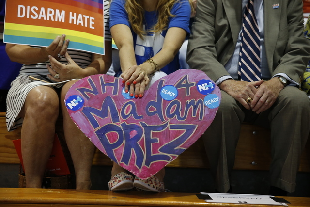 A woman holds poster for Democratic presidential candidate Hillary Clinton during a rally in Portsmouth, N.H., Tuesday, July 12, 2016, where Sen. Bernie Sanders, I-Vt., endorsed her for president. ...