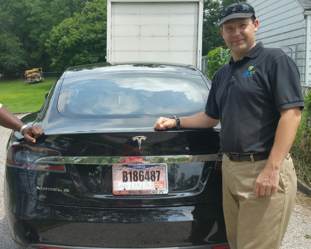 Joshua Brown stands by his new Tesla electric car near his home in Canton, Ohio, in 2015. Brown died in an accident in Florida on May 7, 2016, in the first fatality from a car using self-driving t ...