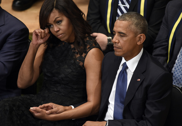 President Barack Obama and first lady Michelle Obama attend an interfaith memorial service for the fallen police officers and members of the Dallas community at the Morton H. Meyerson Symphony Cen ...
