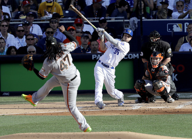American League's Eric Hosmer of the Kansas City Royals hits a home run off National League starting pitcher Johnny Cueto of the San Francisco Giants during the second inning of the MLB baseball A ...