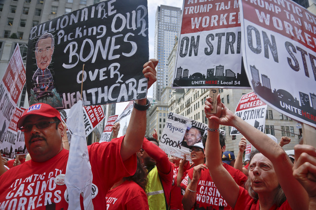 Striking workers from New Jersey's Trump Taj Mahal casino join supporters of Local 54 from the Unite-HERE union to protest outside the Fifth Avenue office of Carl Icahn, Wednesday, July 13, 2016,  ...