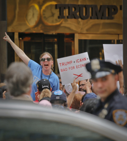 Striking workers from New Jersey's Trump Taj Mahal casino and members of Local 54 from the Unite-HERE union protest outside Trump Towers on Fifth Avenue, Wednesday July 13, 2016, in New York. The  ...