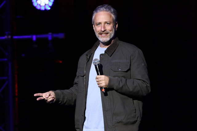 """FILE - In this Tuesday, Nov. 10, 2015, file photo, comedian Jon Stewart performs at the 9th Annual Stand Up For Heroes event, in New York. Stewart delivered a riff reminiscent of his """"Dai ..."""